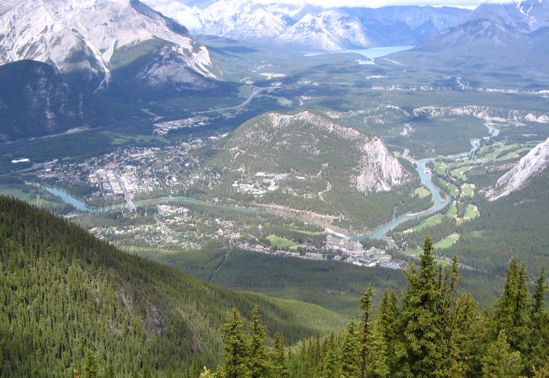 Photograph looking down on Banff - the Banff Centre is located in a valley with mountains rising all around.