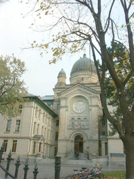 Photograph of an entranceway to Dawson College - the historic stone building is capped with a green copper dome