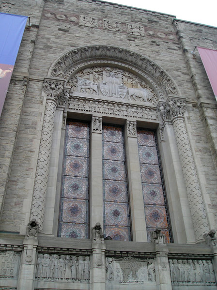Photograph of a very ornate stained glass window facade of the ROM